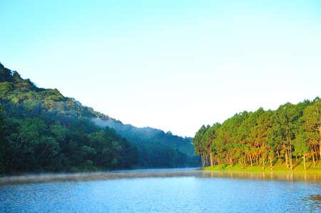 First sunshine at Pang-ung lake, Maehongson, Thailand photo