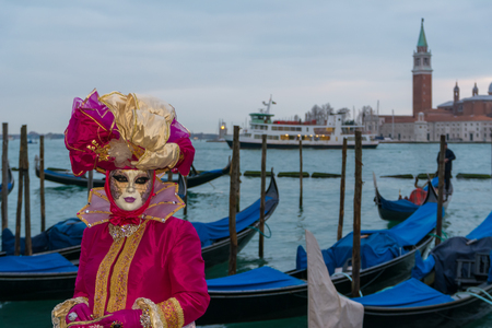 disguised: A woman disguised in the Venice carniva