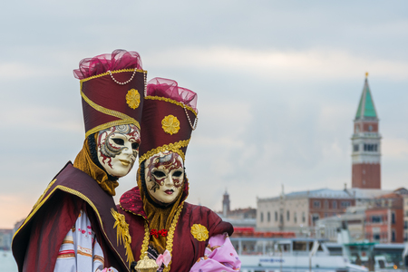 disguised: A couple of masked people in Venice carnival