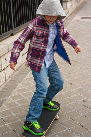 skate board: A boy playing on His skate board on the street