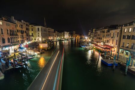 rialto: View of Venice canal from Rialto bridge at night, Venice, Italy Editorial