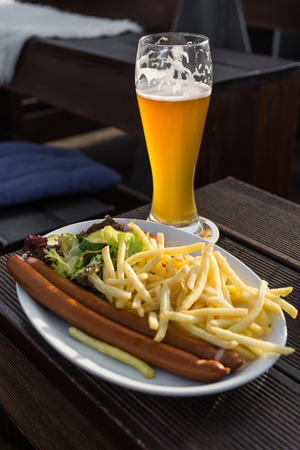weiss: Grilled sausages with french fries and beer weiss Stock Photo