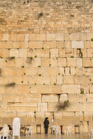 wailing: Orthodox Jewish man prays in the Wailing Wall of Jerusalem, Israel Stock Photo
