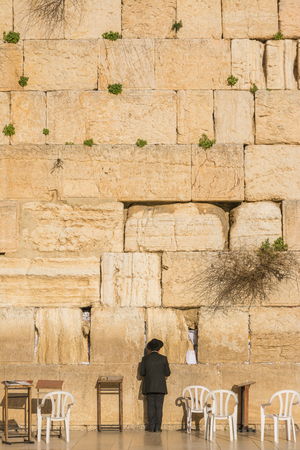 Orthodox Jewish man prays in the Wailing Wall of Jerusalem, Israel Stock Photo