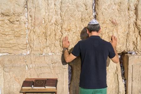 wailing: Jewish tourist prays in the wailing wall of Jerusalem, Israel Stock Photo