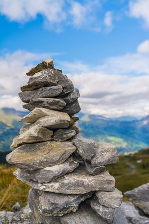 cairn: Small cairn With snowy alpine mountains at background