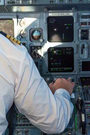 throttle: Pilot in the cockpit pulling the throttle aircraft to commercial flight During