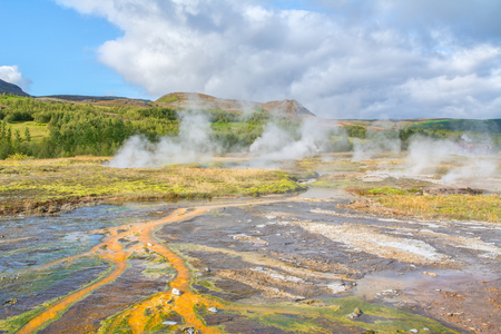 Hot springs in geothermally active Haukadalur Valley, Iceland Stock Photo