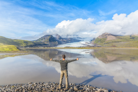 Man enjoying the amazing view in Fjallsarlon glacial lagoon, Iceland