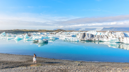 Couple celebrating their wedding in Jokulsarlon glacial lake, Iceland