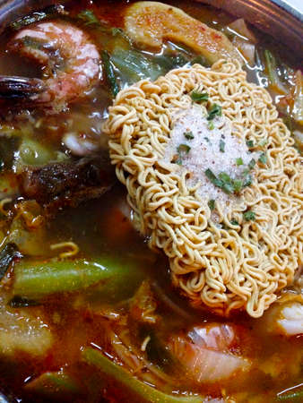 vietnamese food: dried noodle topping on spicy soup Vietnamese food