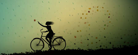 Autumn rain, girl riding on the bicycle and autumn leaves swirling and rain starte