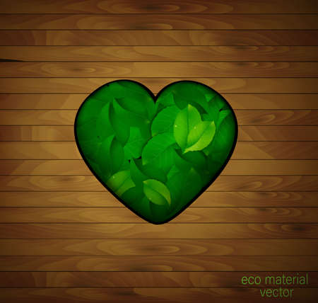 wood heart, love for natural material concept, green heart full of leaves in the wooden floor,