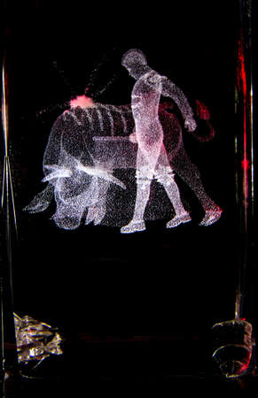 BULL AND A BULLFIGIHTER IN A GLASS MADE WITH LIGHT PAINTING