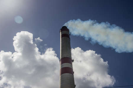 CHIMNEY,CLOUDS AND SMOKE, NEAR TO AN INDUSTRIAL ZONE