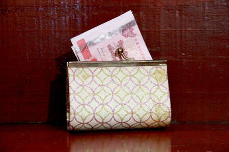 Gold wallet with Thai Paper Currency photo