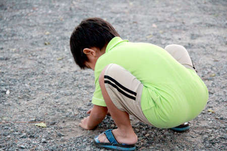 dirt: The little boy playing soil in dirt