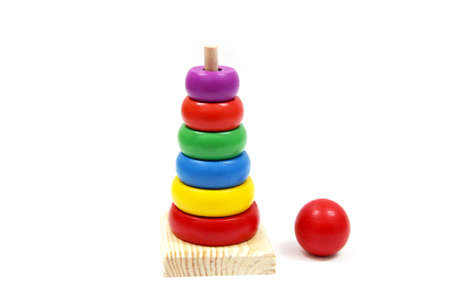 curator: Rainbow tower wood toy  isolated on white