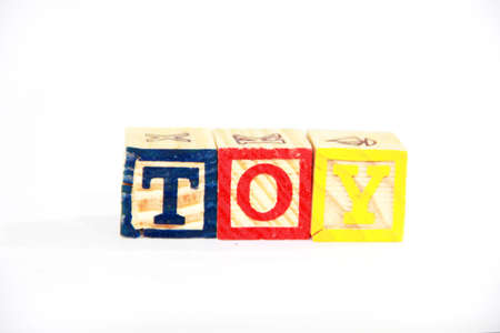 alphabet blocks: alphabet blocks on a white background spelling out the words TOY