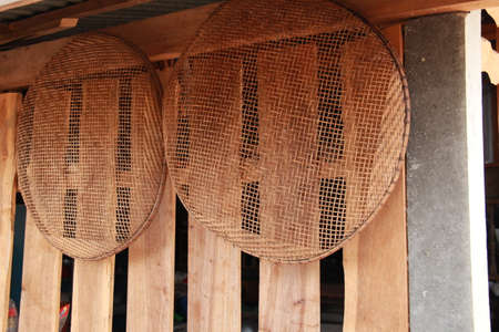 winnowing basket, bamboo threshing basket use for food airing hang  on  wood wall