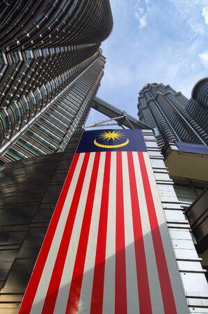 KUALA LUMPUR, MALAYSIA Petronas Twin Towers, KLCC, low angle, with malaysia flag Editorial