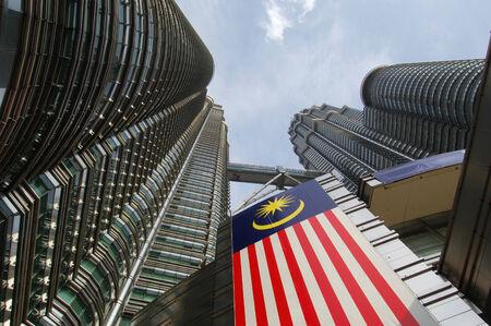 KUALA LUMPUR, MALAYSIA Petronas Twin Towers, KLCC, low angle, with Malaysia flag