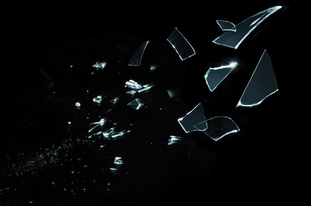 shot glass: Shattered and splitted glass Pieces isolated on black