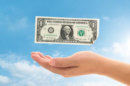 money falling: money falling into hand