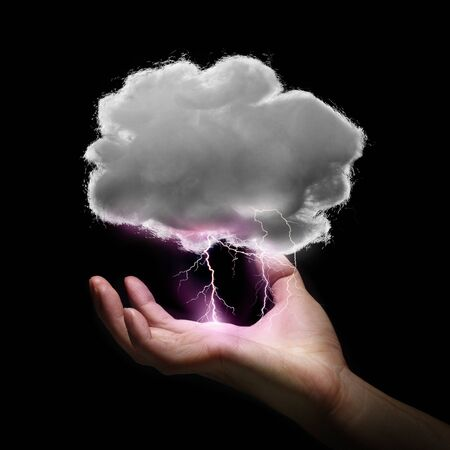 cotton cloud: hand hold thunderbolt and cloud make from cotton Stock Photo