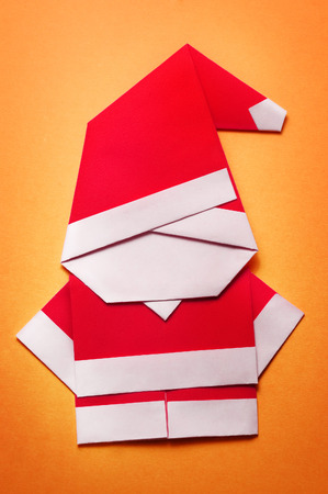 Origami Santa Claus Paper Craft On Orange Background Stock Photo