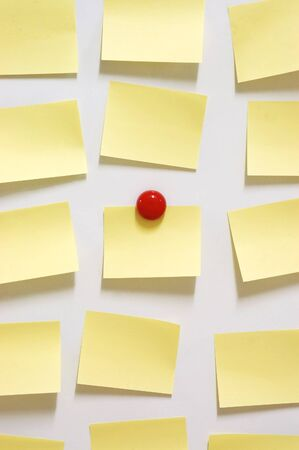 post it: yellow post it note and magnet button on whiteboard Stock Photo
