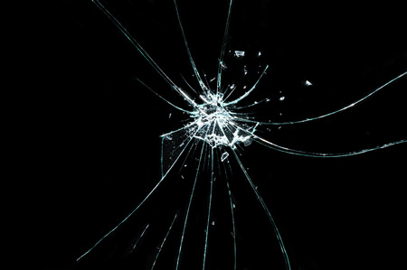 cracked glass: broken cracked glass in black background