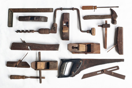 Collection of antique woodworking tools, isolated on white