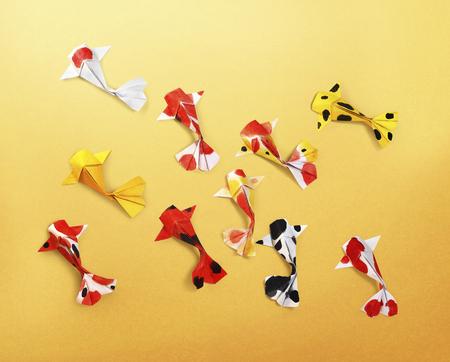 handmade paper craft origami koi carp fish on yellow background Standard-Bild