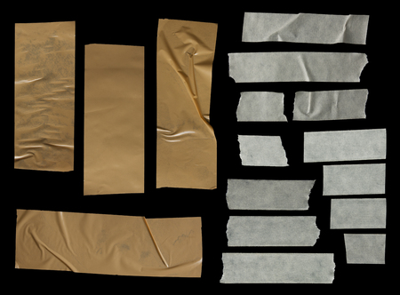 adhesive: collection of various adhesive tape pieces on black background.