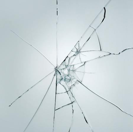 Broken window glass crack splitter on white gray background Standard-Bild