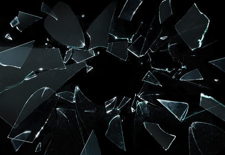 broken glass with sharp pieces over black background
