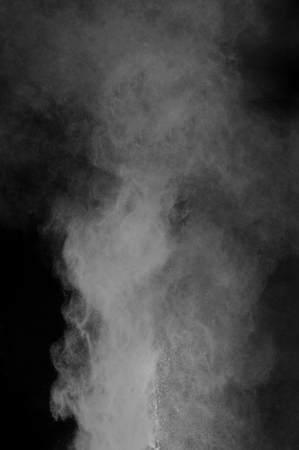 powder explosion with smoke on black background