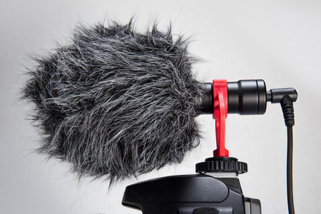 Professional cardioid Directional Condenser Video Microphone black color attach on DSLR camera isolated on withe. Banco de Imagens