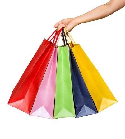 Eine Frauenhand trägt einen Haufen Einkaufstüten isoliert auf weiß Standard-Bild