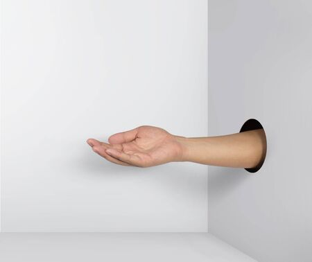 Outstretched hand gesture, holding, asking or offering something, coming out from a hole of paper.