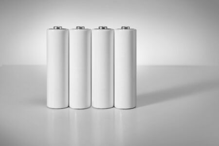 Close up white AA batteries over white background