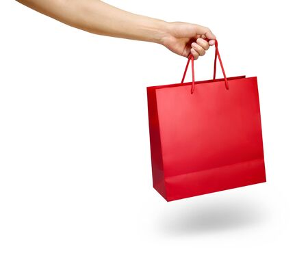 Hand holding red colour shopping bag isolated on white
