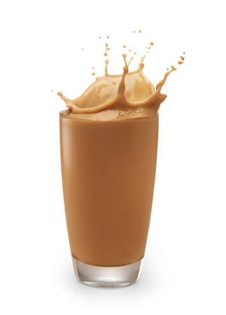 chocolate milk or milk tea splashing out of glass isolated on white background Banco de Imagens