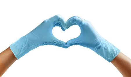 Hands of a nurse in blue latex gloves. The heart is made of hands.