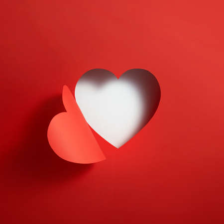 Heart shape hole through paper