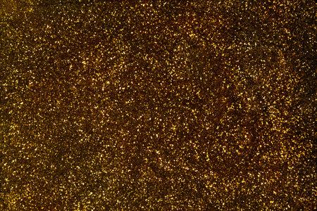 Sparkling golden glittering texture as background