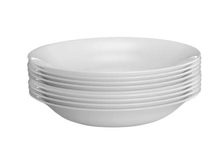 White plates stacked together isolated on white