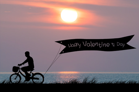 valentino: Happy Valentines Day, silhouette man bike at twilight sunset sky time