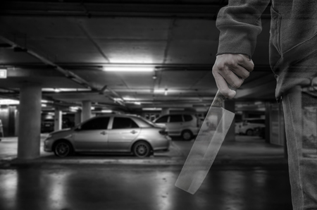 looting: Car thief at parking lot ( criminal concept )